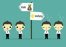 Active man choose risk but lazy man choose safety. Two businessman who active stand risk zone but two businessman who lazy stand safety zone Stock Image