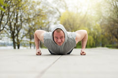 Active man doing push up in park. Royalty Free Stock Photos