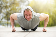 Active man doing push up in park. Royalty Free Stock Photo