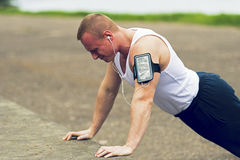 Active man doing pushups outdoor. Royalty Free Stock Images