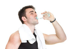 Active man drinking water after training Royalty Free Stock Image