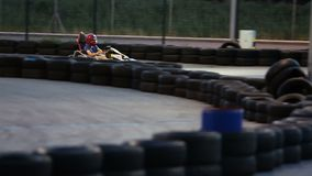 Active man enjoying speed at kart racing, having fun at karting club, male hobby. Stock footage stock video
