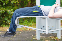 Active man exercising on bench outdoor. Stock Photography