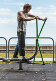 Active man exercising on elliptical trainer. Royalty Free Stock Photography