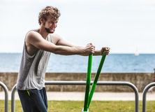 Active man exercising on elliptical trainer. Royalty Free Stock Photos