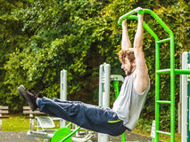 Active man exercising on ladder outdoor. Active young man exercising on ladder. Muscular sporty guy in training suit working out at outdoor gym. Sport fitness Royalty Free Stock Photography