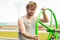 Active man exercising with tai chi wheel. Stock Photography