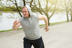 Active man jogging in park. Runing fit. Stock Image