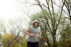 Active man jogging in park. Runing fit. Royalty Free Stock Photography