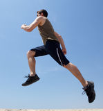 Active man jumping in the air Stock Image