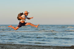 Active man jumping high and running at seashore Stock Photos