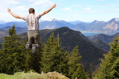 Active man is jumping up. Nature in background royalty free stock image