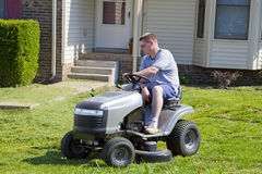 Active Man Mowing lawn and Landscaping Royalty Free Stock Photography
