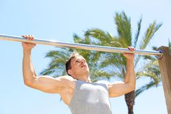 Active man pull up exercise workout. Outside stock photography