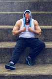 Active man resting after workout. Stock Image