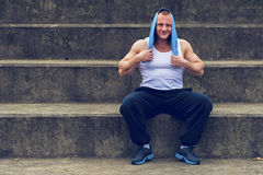 Active man resting after workout. Royalty Free Stock Images