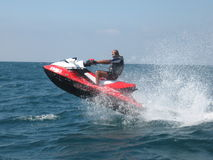 Active man riding a red jet ski in the Red Sea Stock Photography
