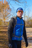 Active man in sunglasses trains in sunny fall day. On the background of the autumn landscape in park royalty free stock photos