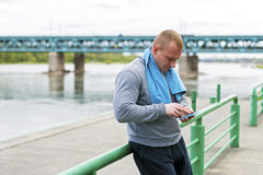 Active man using smartphone. Stock Images