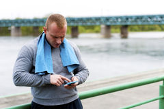 Active man using smartphone. In city park Royalty Free Stock Photo