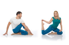 Active man and woman doing yoga fitness poses stock photography