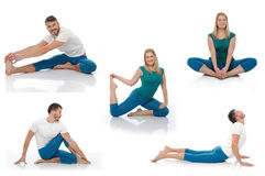 Active man and woman doing yoga fitness poses Stock Images