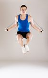Active man. Young active man with rope is training in studio royalty free stock photos