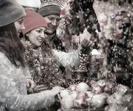 Active married couple with a teenage daughter at Christmas marke Stock Photography