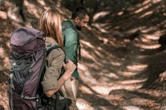 Active married couple walking in the woods royalty free stock photography