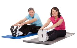 Active mature couple doing fitness Stock Photo