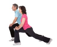 Active mature couple doing fitness Royalty Free Stock Images