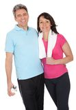 Active mature couple doing fitness Stock Photos