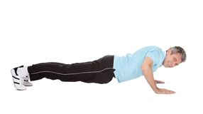 Active mature man doing pushups Royalty Free Stock Photos