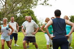 Active Mature People with fitness Trainer Royalty Free Stock Photos