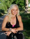 Active mature woman on a bike. A healthy mature woman on a bike path Stock Image