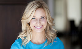 Active Mature Woman Smiling At The Camera Stock Photo