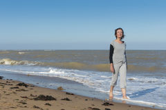 Active mature woman walking in the sea. Active mature woman walking peacefully in the sea Stock Photography