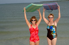 Active mature women at beach Stock Photos
