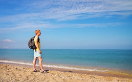 Active men with backpack on the shore. Royalty Free Stock Photos