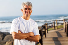 Active mid age man. In sportswear on the beach Royalty Free Stock Photo