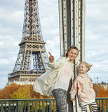 Active mother and child pointing on something near Eiffel tower Royalty Free Stock Photography