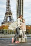 Active mother and child standing on Pont de Bir-Hakeim bridge Stock Images