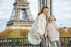 Active mother and daughter on Pont de Bir-Hakeim bridge in Paris Stock Images