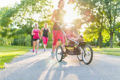 Active mother jogging Stock Photography
