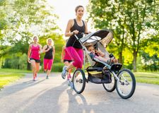 Active mother jogging Royalty Free Stock Photography