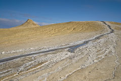 Active mud volcano river Royalty Free Stock Images