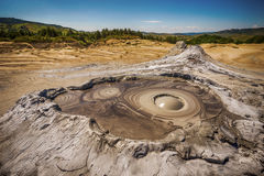 Active muddy volcano. Closeup on an active muddy volcano cone with mud bubbles coming out royalty free stock images