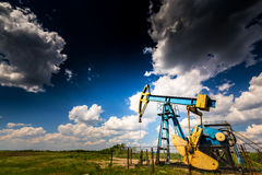 Active oil and gas well. Oil and gas well, in remote rural area in Europe royalty free stock photos