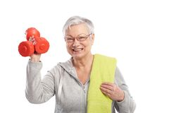 Active old lady with dumbbells smiling. Active old lady holding dumbbells, smiling stock photos