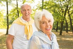 Active older couple. Happy active older couple spending time in the forest royalty free stock photos